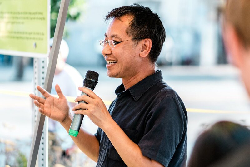 Jeff Hou speaks into a microphone
