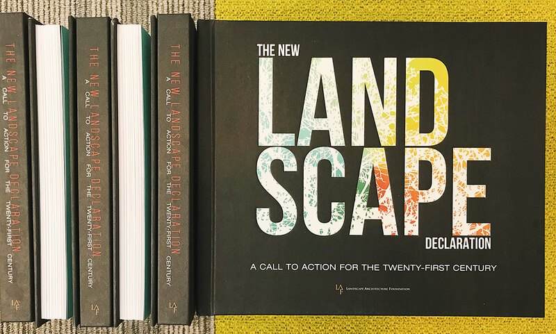 A stack of the New Landscape Declaration books, showing the cover and spine
