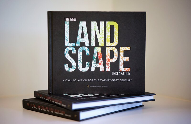 The New Landscape Declaration book with cover displayed on a stack of two