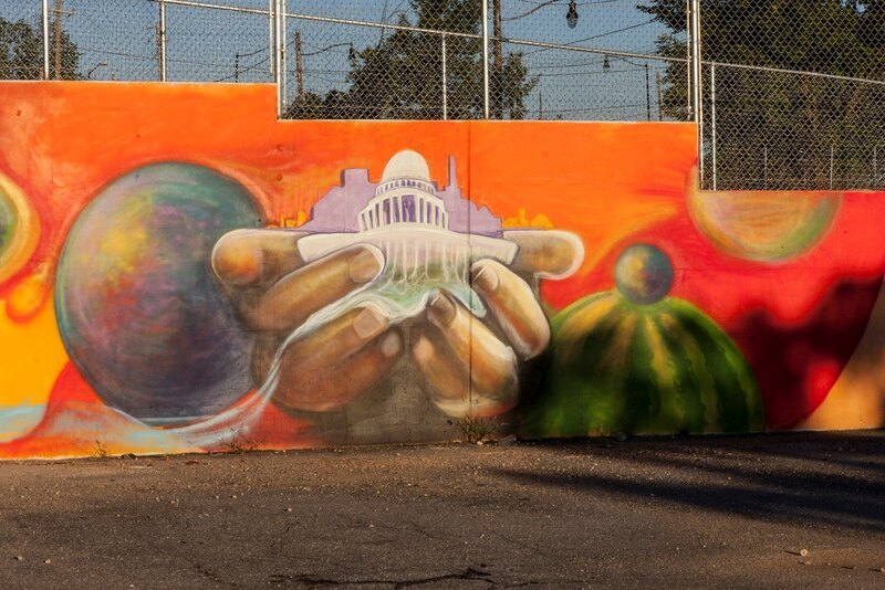 Mural in farmer's market area by Ward 7 artist Jay Coleman, planned and painted with teen volunteers.