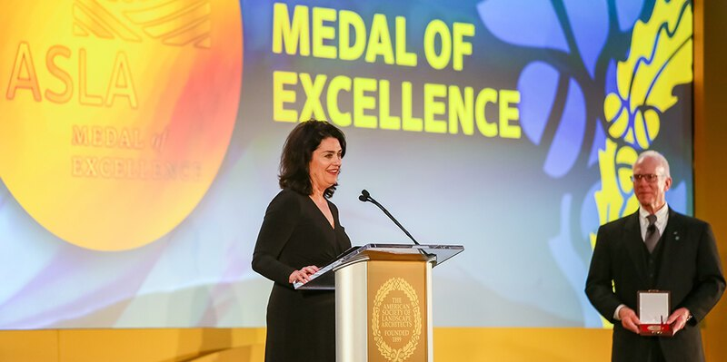 LAF CEO Barbara Deutsch at a podium receiving the ASLA Medal of Excellence