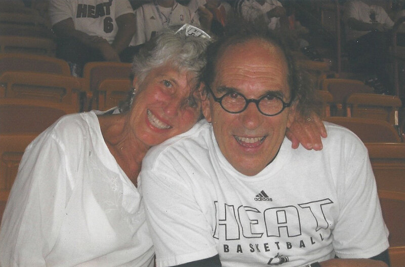 Jeanne and Joe Lalli smiling in the bleachers at a Miami Heat game