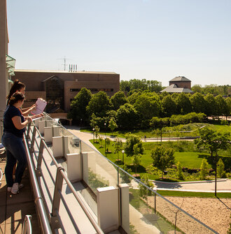 Two research observe and record site use on the University of Michigan North Campus