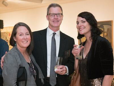 Jennifer Guthrie, Duane Krueger, and Lisa Switkin pose together at the 2018 LAF Annual Benefit
