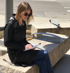 LAF Research Assistant Hannah LoPresto inventories P Street's site elements while seated on a limestone bench
