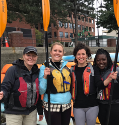 Olmsted Scholars and event attendees prepare to kayak at an LAF Olmsted Scholar bioregional event