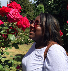 Jescelle smelling roses in a garden